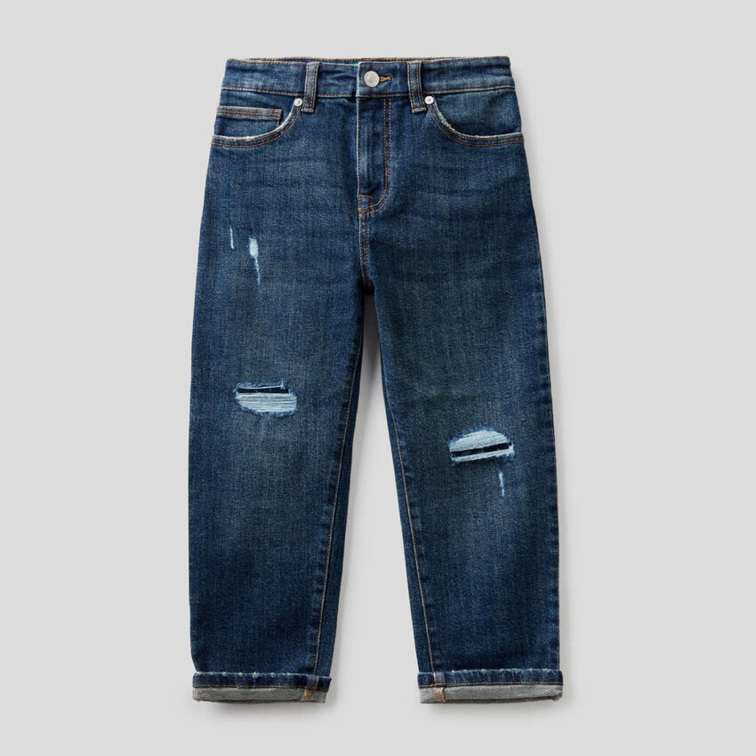 Jeans slouchy com rasgos