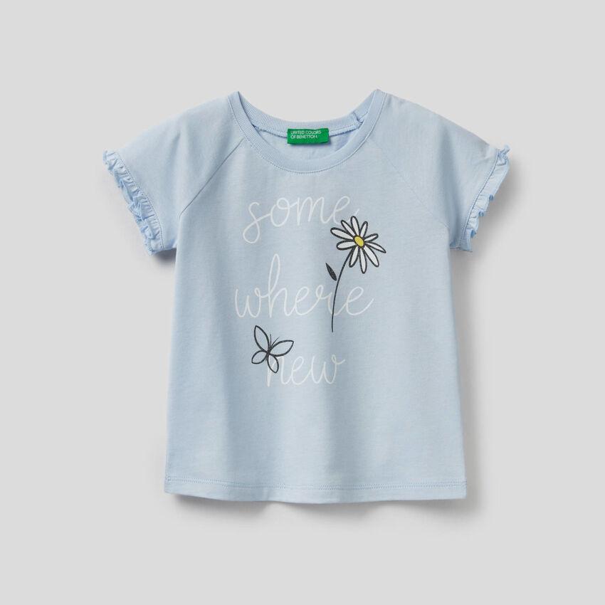T-shirt com folhos e glitter